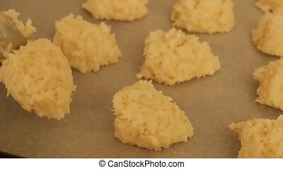 Unbaked coconut macaroons - Coconut macaroons on a baking...