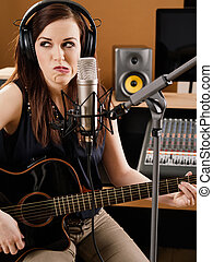 Uncertainty in the recording studio - Photo of a beautiful...