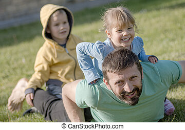uncle playing with children
