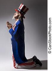 Uncle Sam in Prayer - Uncle Sam kneeling in prayer