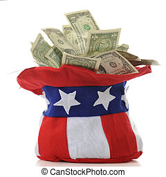 Closeup of an Uncle Sam hat overflowing with US dollar bills. On a white background.