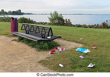 Uncollected rubbish at picnic place near lake - Uncollected...
