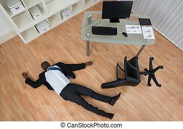 Unconscious Businessman Lying On Floor