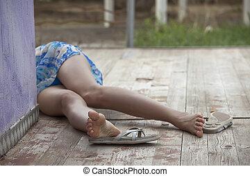 unconscious female victim - model playing a unconscious...