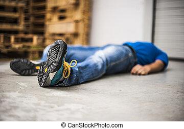 unconscious man after accident - an unconscious man needing...