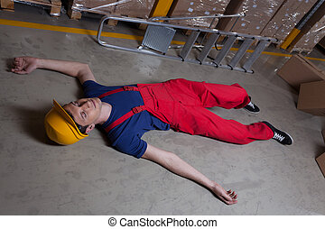 Unconscious man in a factory - Unconscious man on the floor...