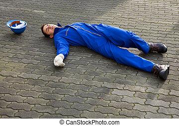 Unconscious Repairman In Uniform Lying On Street - Full...