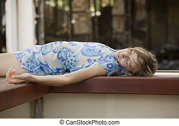 unconscious woman in short dress lying outdoor