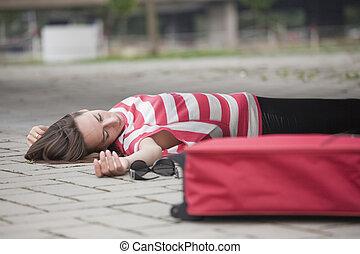 unconscious woman on asphalt road - unconscious woman lying...