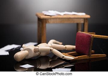 Unconscious Wooden Dummy Figure Lying On Floor
