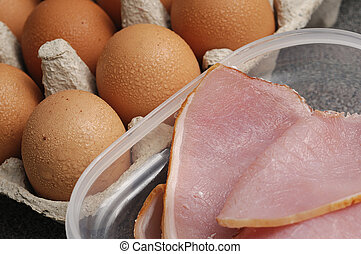 Uncooked bacon and eggs