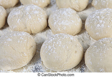 Uncooked bread rolls - A tray of breakfast rolls rising just...