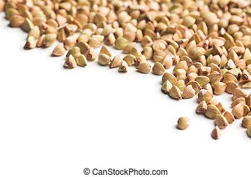 uncooked buckwheat on white background