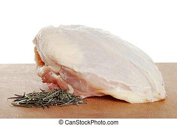 uncooked chicken breast rosemary - closeup uncooked chicken...