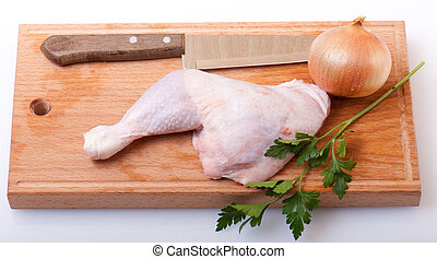 uncooked chicken on a wooden cutting board