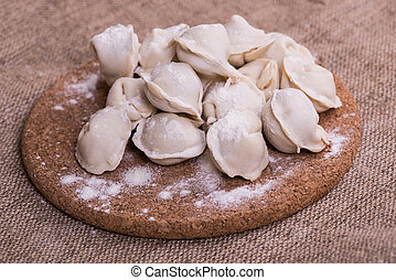 Uncooked dumplings Pelmeni. Traditional Russian dish....