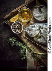 Uncooked fresh fish with herbs and spices