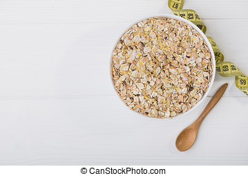 uncooked grain of oatmeal in white bowl