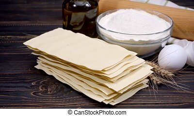 uncooked lasagna pasta sheets and ingridients - dried...