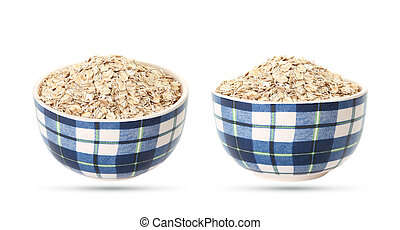 Uncooked oatmeal in a bowl, dry oat flakes isolated on white