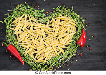Uncooked pasta laid out in the shape of a heart
