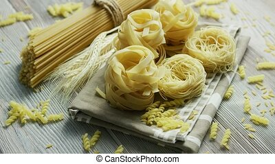 Uncooked pasta of different sort - From above view of...