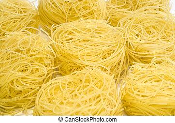 Rolls of uncooked pasta
