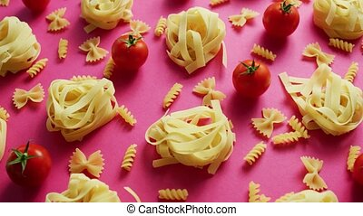 Uncooked pasta with fresh tomatoes - From above view of...