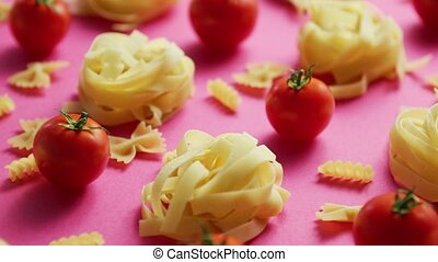 Uncooked pasta with fresh tomatoes - From above view of ...