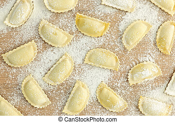 Uncooked ravioli pasta prepared and ready for cooking from above