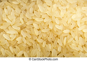 Uncooked rice close up on wooden table