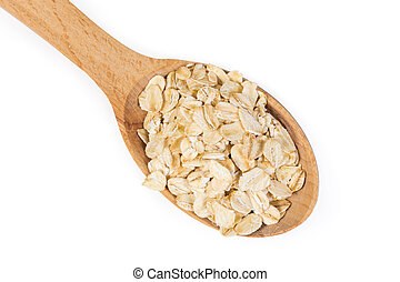 Uncooked rolled oats in wooden spoon on a white background