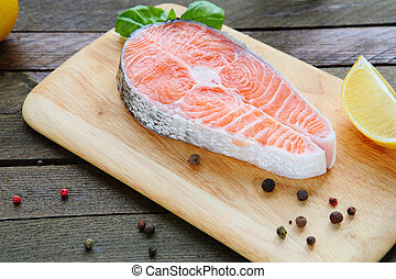 uncooked salmon with spices, food closeup