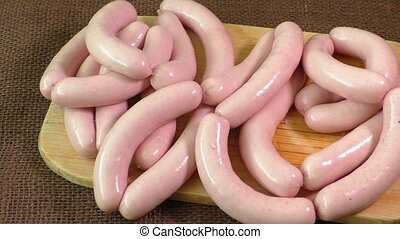 Uncooked sausage on the chopping board