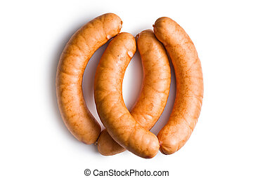 uncooked sausages on white background
