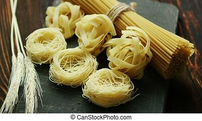 Uncooked spaghetti and wheat - From above view of unprepared...