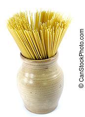spaghetti -  uncooked spaghetti in an earthenware pot.