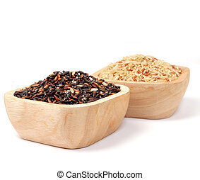 Uncooked thai black rice in a wooden bowls