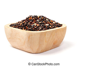 Uncooked thai black rice in a wooden bowls on white