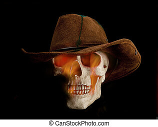 Undead cowboy - Scary flaming human skull is wearing cowboy...