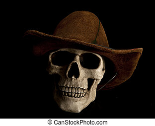 Undead cowboy - Scary human skull is wearing cowboy hat