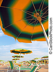 under a parasol on the beach in summer without people