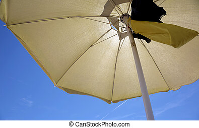 Under a yellow parasol in the summer