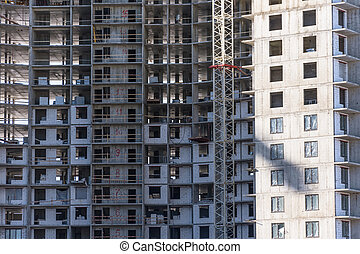 Under construction apartment building and residential real estate, close up view