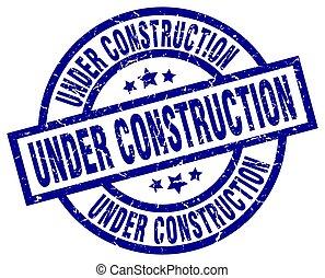 under construction blue round grunge stamp