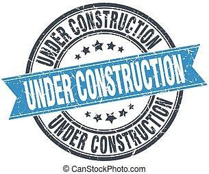 under construction blue round grunge vintage ribbon stamp