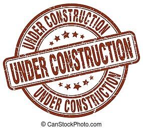 under construction brown grunge round vintage rubber stamp