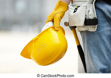 under construction - builder with yellow helmet and working ...