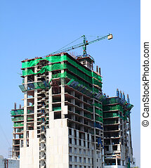 Under construction building with blue sky in bangkok