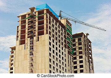 Under construction building with blue sky